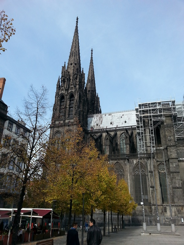 drive clermont ferrand woman enjoying morning view on the famous cathedral in city in france. Black Bedroom Furniture Sets. Home Design Ideas
